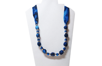 Christmas necklace in midnight blue with silver beads.