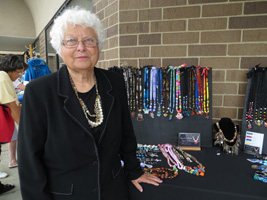 A picture of Bonnie selling her necklaces at a show.
