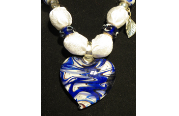 White necklace with blue glass heart