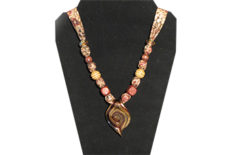Pine cone pattern fabric with glass pendant with gold tones