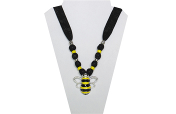 A fun bumblebee necklace on black cotton fabric with metal bumblebee for pendant