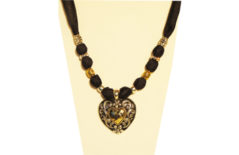 Black silky necklace with gold and silver tone metal heart.