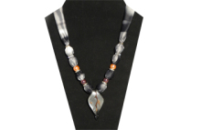 Elegant white, gray and black silky fabric with gray glass leaf pendant.