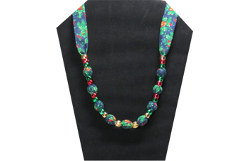 Christmas necklace with red , green and gold pony beads on deep blue cotton fabric with pony beads