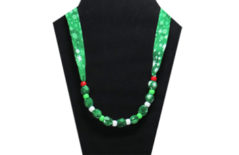 Christmas necklace on green cotton fabric with white, green and red pony beads