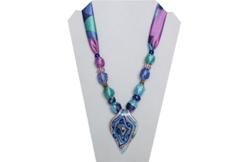 Necklace is multi-color pastels with pointed pendant