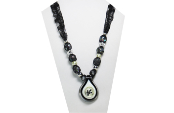 Vintage necklace in black and white with lacy fabric and glass pendant