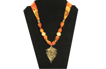 Fall theme necklace with sunflower printed fabric and glass leaf pendant