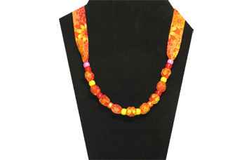 Bright yellow and orange cotton fabric with pony beads.