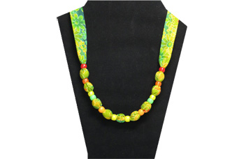 A bright yellow and green spring/summer pony bead necklace with cotton fabric
