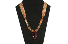 Pine Cone patterned fabric necklace with red/black/gold glass pendant