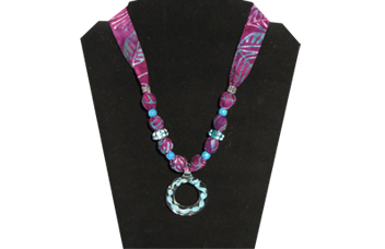 Purple necklace with round glass bead