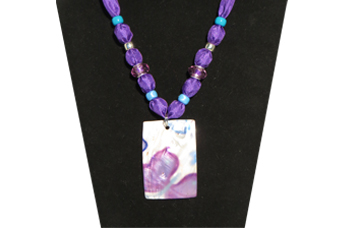 Closeup of Purple Necklace with Shell Pendant