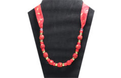 Christmas necklace with gold pattern on red fabric with pony beads