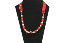 Christmas necklace on red cotton fabric with snowflake pattern with pony beads