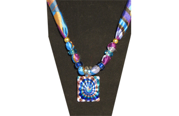 Multi-colored necklace with square multi-colored pendant.
