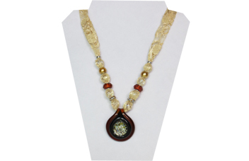 Vintage style necklace with ivory lacy fabric and round glass pendant