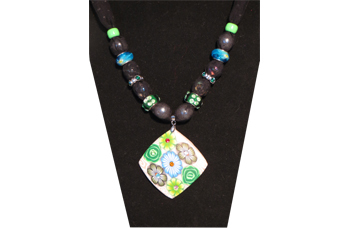 Necklace with shell-like pendant with green and blue flowers