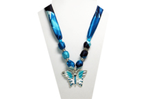A blue and teal necklace with metal butterfly pendnat