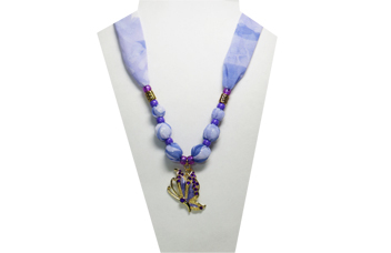 A lavender colored necklace with purple butterfly