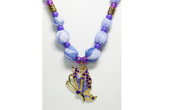 A purple/lavender necklace with metal butterfly pendant