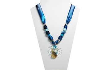 A blue/teal multi-colored necklace with seashore themed pendant