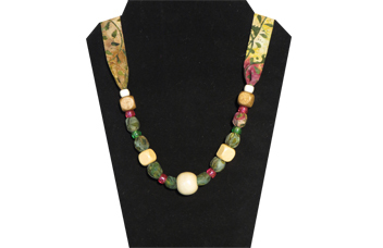 Necklace with cotton green/brown foliage pattern and wooden beads