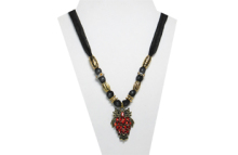 This necklace is a gold metal owl with diamond shaped red glass rhinestones. The fabric is black sheer sparkly and has gold tone and gold rhinestone beads.
