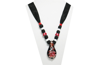 This necklace has a black and red glass pendant with a cute raised glass frog on top. The fabric is black cotton with tiny gray flowers. The beads are red and white pony beads and red glass with white polkadots.