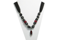 This necklace has a silver tone metal flip-flop pendant with garnet looking insole and a clear and red rhinestone flower on the strap. The fabric is black sheer sparkly with beads that are silver tone metal and garnet color faceted beads.
