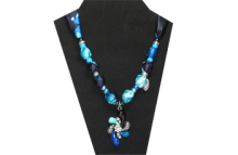 The pendant on this necklace is swirl with arms of blue, black, turquoise and silver tone metal. The center of the pendant is a multi-color rhinestone flower. The fabric is silky blue multi-colored. The beads are silver tone metal, black and turquoise pony beads. It has cute heart locket charm of silver tone metal.
