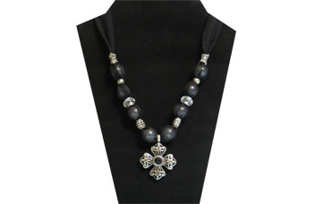 This necklace has a black cross pendant with a faceted black bead in the center. The sheer black sparkly fabric have clear faceted and silver tone accent beads.